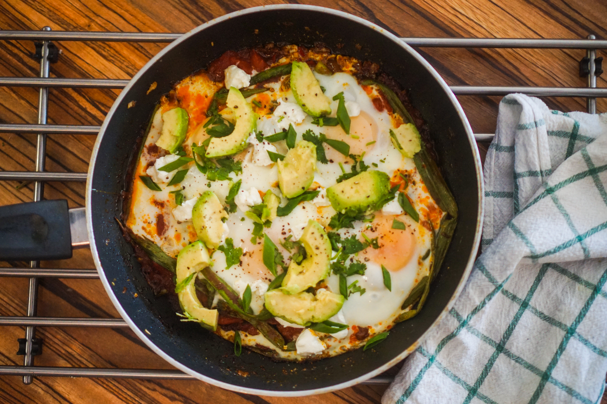 Spicy Shakshuka with Green Onion, Goat Cheese, & Avocado